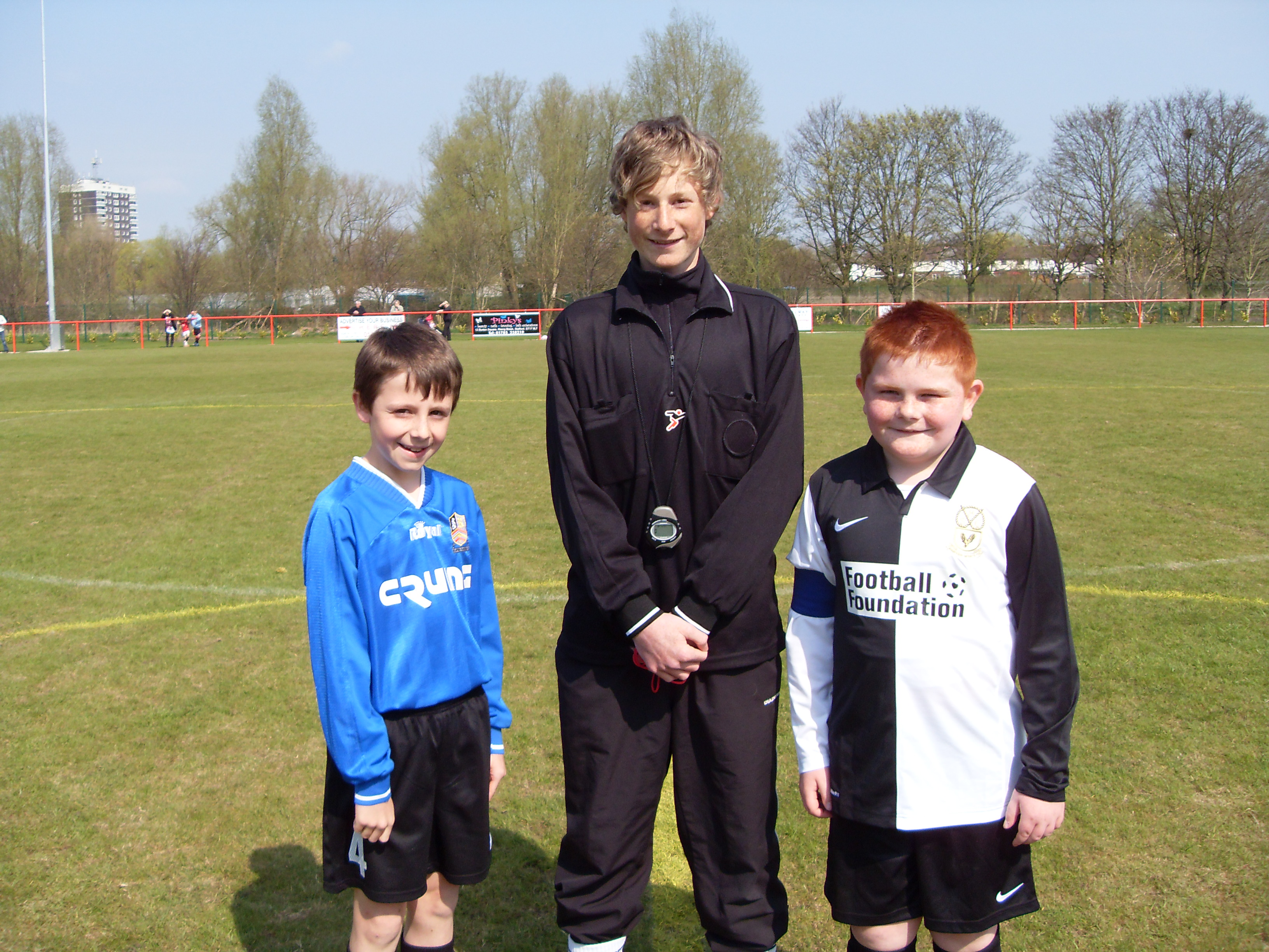 Ref Ryan Ashton with captains from Staff Rang Jun & Hawkins