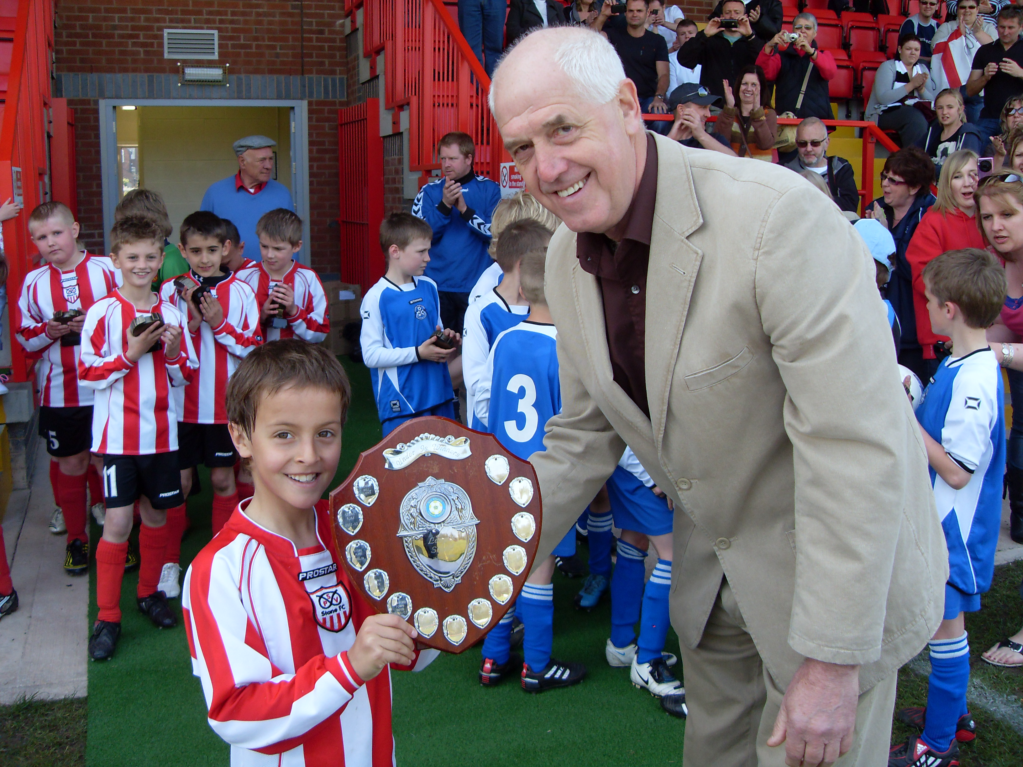 PSV Stone captain winners under 9s Shield with Gordon Evans
