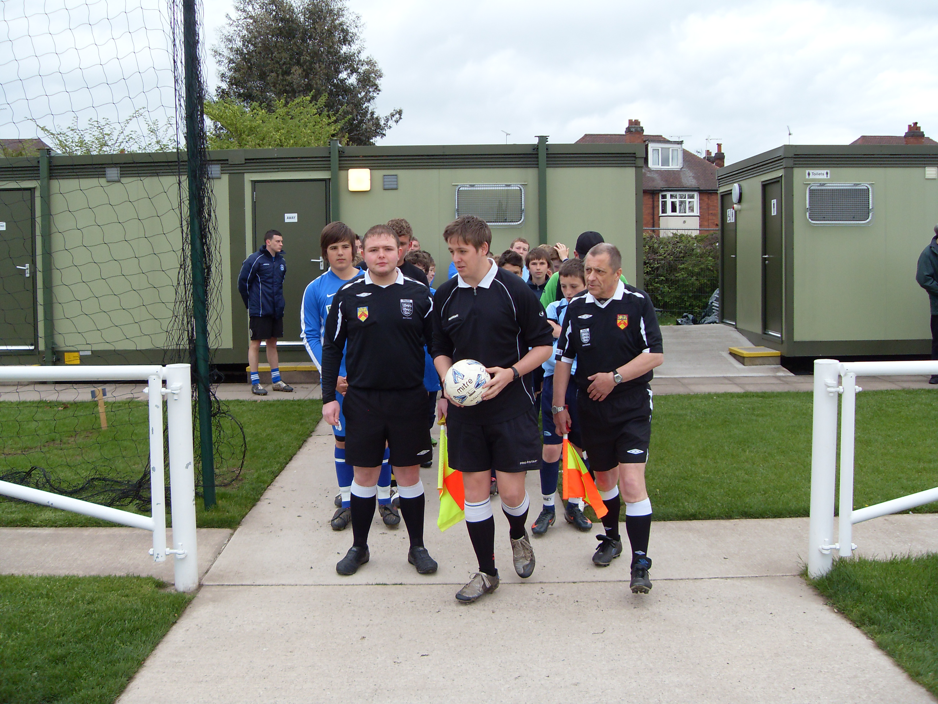Refs lead out teams under 13s Shield Final