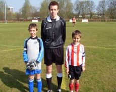 Referee James Cameron with Captains from under 9s final